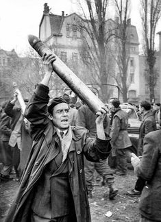A fighter triumphantly holds up a looted Soviet tank shell, which arrived in a truck to be used in rebel tanks flying Hungarian flags Old Photos, Vintage Photos, Hungarian Flag, Border Guard, Freedom Fighters, Interesting History, Budapest Hungary, Soviet Union, Life Magazine