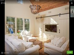 Hidden TV - Cottage - living room - Thompson Custom Homes Barn Door Designs, Cool House Designs, Traditional Style Homes, Traditional Design, Cottage Living Rooms, Cottage Homes, Boho Home, Family Room Design, Family Rooms