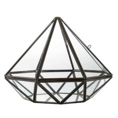 Accent your beautiful home with a Black Metal & Glass Diamond! This delicate piece of décor is entirely made of 2 sizes of glass panels and metal trim which