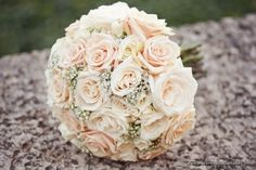 Wedding bouquet. Pink roses with baby's breath. So beautiful