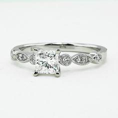 18K White Gold Tiara Diamond Ring, set with beyond conflict free .70ct. princess diamond
