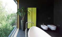 Design Detail – A Bathroom With Black Walls And A Black Floor