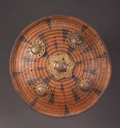 aceh shield | patterned rattan and brazz