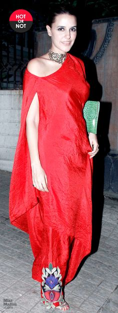 Neha Dhupia attended the comedy show, Battle Of Da Sexes, wearing a fiery red Anamika Khanna outfit. How would you rate her look? Vote here!