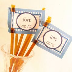 """Love is Sweet"" honey stick favors $4.95 for 20 honeysticks  available here:   http://www.stashtea.com/Stash-Tea-Original-Clover-Sticks/dp/B00747K3C2"