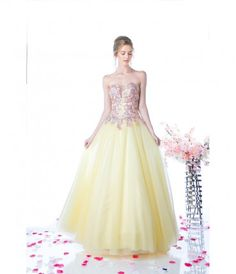 Bright and dreamy! The beautiful tulle skirt is a soft yellow color that will make you feel like royalty. The lovely str...Price - $310.00-Od6DgWkC