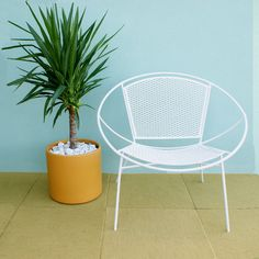 Decorate your patio with some smooth curves  (Salterini Hoop Mid Century Patio Lounge Chair. $300.00, via Etsy.)