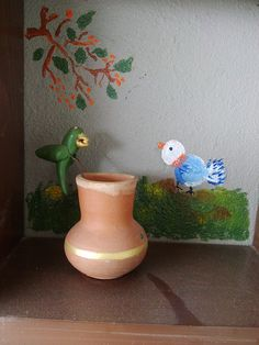 Hand painted birds on the balcony  shelf