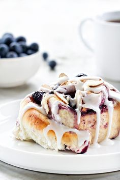 Blueberry Sweet Rolls a like a cinnamon roll but filled with blueberries. Sweet and indulgent!
