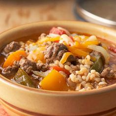 Slow Cooker Stuffed Pepper Soup-This is a hearty and also healthy recipe. It is low in calories and fat and a Weight Watchers 6 PointsPlus+ recipe also. It has all the ingredients of stuffed peppers made in a slow cooker and cooks all day. Ground beef (turkey!), bell peppers, onions, rice, tomatoes and cheese combine for a delicious meal. Makes 8 (1-1/4 cup) Servings.