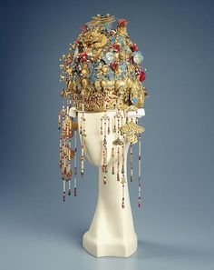 HEADDRESS & HAIR ORNAMENTS, 19th century, Chinese, Headdress w.dragons, pheonix, flowers, auspicious motifs, hanging beading.Gilt metal, kingfisher feathers