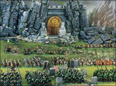 Une armée de Nains Warhammer devant la porte monumentale de leur forteresse sous la montagne. (Photo Games Workshop)