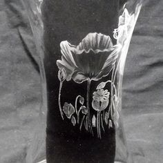 Glass engraving of poppies on a vase by Paul Amphlett. Paul explains in this article how to create shade when glass engraving.