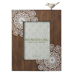 Wood picture frame with a lace doily motif and bird accent.  Product: Picture frameConstruction Material: Wood a...