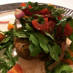 Chicken Milanese topped with a fresh tomato and arugula salad