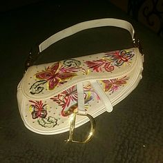 Dior saddle bag Gorgeous Dior saddle bag. White canvas with beautiful  embroidered butterflies. Dior 097ed5bf483c1