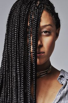 We're totally here for Tia Mowry's head full of jet black box braids.