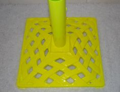 Fluro / Neon Yellow Umbrella Stand.  I am powdercoated and will withstand the outside elements.