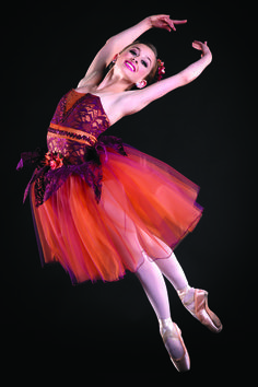 Leap into performance season with beautiful ballet costumes like this romantic tutu with lace accents by A Wish Come True Dance Costumes. #FashionFriday
