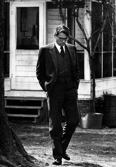 Gregory Peck between scenes of To Kill a Mockingbird (1962). He still looks like he's in character. He and James Stewart have got to be my favorite actors from way back when :)