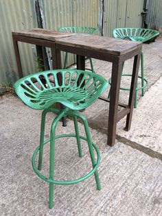 'Tractor seat' bar/ breakfast stool in cast iron and steel. Adjustable height. Hoop foot rest. Rustic finish, in 'John Deere' green. Also available in Massey Ferguson red. £ 98 each / £360 set of 4