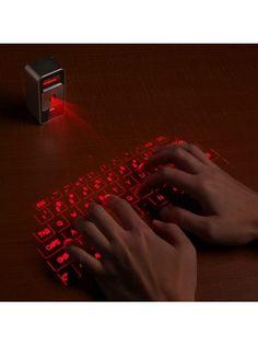 Лазерная клавиатура Magic Cube. Magic Cube - это лазерный манипулятор, который выводит клавиатуру на любую поверхность и с точностью до 99.9% определяет виртуальное нажатие клавиш. Работает с любым планшетом или ноутбуком с помощью USB или Bluetooth связи.