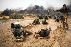 Benghazi, Libya: Rebel volunteers crawl on their stomachs during a military training course before going to the frontline