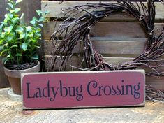 Wooden Signs Ladybug Crossing Springtime Decor by Woodticks