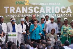 Brazilian President Dilma Rousseff (C) speaks during the inauguration ceremony of the BRT's new line, called Transcarioca.