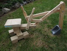 Introducing the sandpit digger. Made from solid pine and steel bolts this sandpit digger is suitable for ages 2 - adult! As well as being amazing fun in the sandpit or garden this sturdy piece of functional machinery helps children develop hand-eye Kids Woodworking Projects, Woodworking Jigs, Diy Wood Projects, Wood Crafts, Projects To Try, Woodworking Furniture, Woodworking Classes, Woodworking Basics, Woodworking Patterns