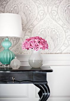 Fresh, yet grounded: love how the subtle pattern and splashes of pretty pink and coastal teal bring just enough whimsy to this traditional vignette: Rio wallpaper in black and white from the Thibaut Artisan Collection.