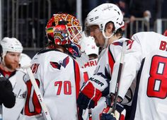 """Braden Holtby and Alex Ovechkin of the Washington Capitals celebrate their Game 2 win vs. the New York Rangers."" They have an odd way of celebrating."