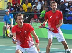 Canada's Vasek Pospisil, left, and teammate Daniel Nestor returns to Spain's Marc Lopez and Rafael Nadal in men's doubles tennis semifinal action at the 2016 Olympic Games in Rio de Janeiro, Brazil on Thursday, Aug. 11, 2016. THE CANADIAN PRESS/Ryan Remiorz