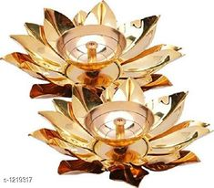 Festive Diyas & Candles Traditional Brass Diya Material: Brass  Size: 6 in Description: It Has 2 Pieces Of Diya Country of Origin: India Sizes Available: Free Size   Catalog Rating: ★4.1 (12205)  Catalog Name: Traditional Brass and Glass Diyas Vol 1 CatalogID_153470 C128-SC1604 Code: 264-1219317-6711