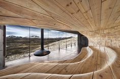 Tverrfjellhytta, Norwegian Wild Reindeer Centre Pavilion, by Snøhetta.  Gyrofocus fireplace by Focus-Creation, France.