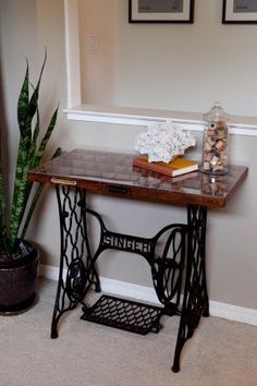 Vintage treadle stand with printer's drawer top...a great way to display and enjoy a miniature collection, and be functional as well.  I have all the ingredients. Hmmmm