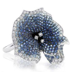 Feeling blue? Give yourself some glitter with our Morning Glory Ring... based on the Nasturtium flower, this is a unique, one-off piece artfully set with blue sapphires and diamonds. This ring is crafted in 18ct white gold. . . . https://shop.gerardmccabe.com.au/collections/30th-birthday-celebration/products/060805