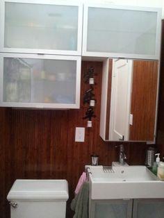 Bathroom storage over bamboo paneling Bamboo Hardwood Flooring, Bamboo Panels, Bathroom Storage, Bathroom Lighting, Mirror, Furniture, Home Decor, Bathroom Vanity Cabinets, Bathroom Light Fittings