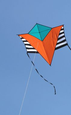 """The minimalist geometric graphic on this kite works well. Structure-wise, it looks like what you get when you cross a Sode kite with a Diamond! T.P. (my-best-kite.com) """"Tan Gram_2012-04-07_111314"""" Cropped from a photo by richdurant on Flickr (cc)."""