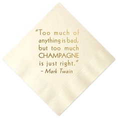 Gold foil cocktail napkin with a Mark Twain quote