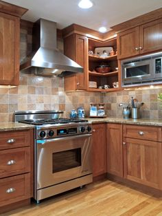 <3 Tiled Kitchen Backsplash Above Range.  I hate our tile now, and even something simple like this would be a huge improvement
