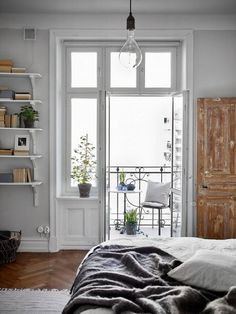 Bedroom Inspiration | Last century wood door amazing windows and balcony. Styling by greydeco
