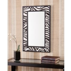 @Overstock.com.com - Ubina Zebra Animal Print Decorative Wall Mirror - This eye-catching animal-print decorative wall mirror provides a colorful accent for your decor. Beautifully crafted and featuring an exotic zebra-print border, this mirror provides a contemporary complement to any area or decorative theme.  http://www.overstock.com/Home-Garden/Ubina-Zebra-Animal-Print-Decorative-Wall-Mirror/7900345/product.html?CID=214117 $126.99