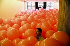 http://idesignme.eu/2012/11/balloon-filled-rooms-by-martin-creed/