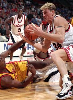 Bobby Brannen, former Bearcat, grabs a loose ball: A tough player who always gave a 100% for Coach Bob Huggins