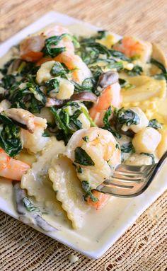Ravioli with Seafood, Spinach & Mushrooms in Garlic Cream Sauce. #recipe #dinner #pasta #sauce