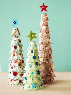 These patterned-paper Christmas trees are easy to make! Learn how here: http://www.bhg.com/christmas/crafts/christmas-holiday-crafts/#page=24
