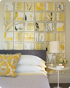 idea for above-bed art: square frames with coordinating scrapbook paper in them. fun. colorful. cheap. easily switched out if you get new bedding. Or try fabric