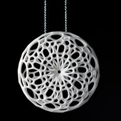 "Cellular pendant - ""Inspired by the complex forms of radiolarians, where intricate pattern is integral to structure, these shapes derive from a simulation of spring meshes which form mirrored catenoid surfaces."" $50"