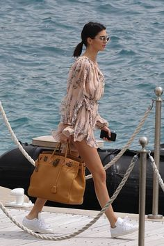 Kendall Jenner stood out on the Cannes red carpet, but it was her off-duty yacht style that really stole the show. Here, we're highlighting her looks.